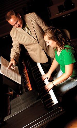 Ken Rodgers works with Katie Miller '12 during a piano lesson.