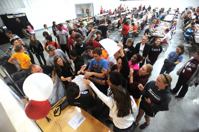Hesston College students and prospective students scramble to pick up a clue sheet for the Homecoming Weekend scavenger hunt. The scavenger hunt sent the students to places around campus that will soon receive updates as part of a capital campaign, and also allowed them to learn about less familiar spots on campus.