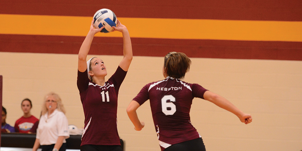 Maggie Lasater sets the ball for Lacey Crenshaw.