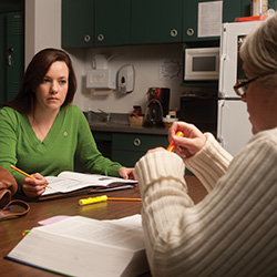Nursing student Amber Baker '13 (Newton, Kan.) discusses course content with a classmate.