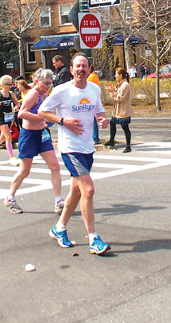 Hesston College alumnus Lynn Fielitz runs the Boston Marathon.