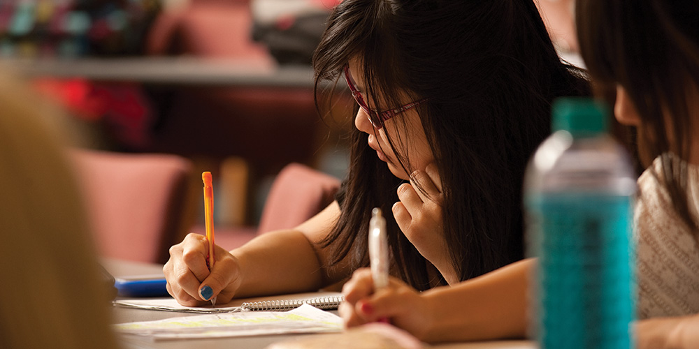 Crisentia Gregor '14 (Banyuwangi, Indonesia) takes notes during class.