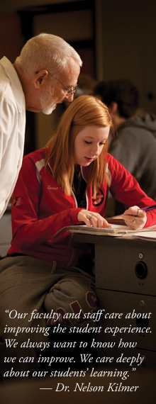 Chemistry instructor Jim Yoder works with Emmie Dudas '13 (Walbridge, Ohio) on lab work. Hesston has the highest score among two-year colleges nationwide for student-faculty interaction.
