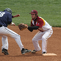 Nick Yoder '14 (Millersburg, Ohio) tags a Brown Mackie (Salina, Kan. runner out.