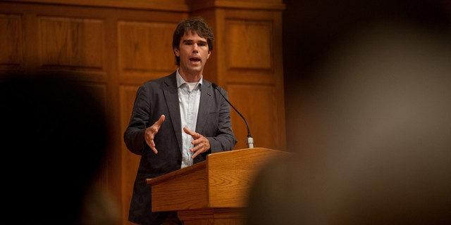 "Warren St. John, author of ""Outcasts United"" shares his experiences and realizations in researching the book during a presentation at Hesston College Sept. 19. ""Outcasts United"" is the college's campus-wide common read for 2013-14 in their study of migration and transformation."