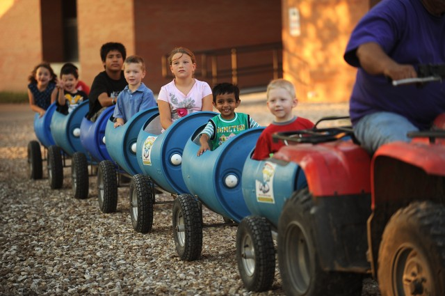 Children enjoy a barrel train ride around campus at the Friday night Family Festival. Alumni, faculty, staff, students and local families came out for the event that included children's activities, a barbecue picnic and Larks athletic events.