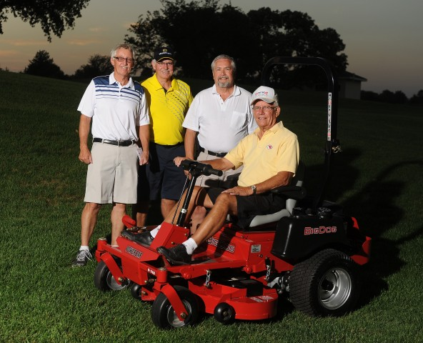 Harold Winsinger of Hesston, Kan., won the Big Dog mower given by Excel Industries at the first Hesston College Student Scholarship Golf Tournament sponsored by Excel. Winsinger returned the mower and it was put up for auction and purchased by Norm Yoder of Henderson, Neb. Pictured from left are Bob Mullet, vice president of Excel; Paul Mullet, president and CEO of Excel; Yoder and Winsinger. The new event hosted 68 golfers and proceeds benefited the Jim Boyts Scholarship.