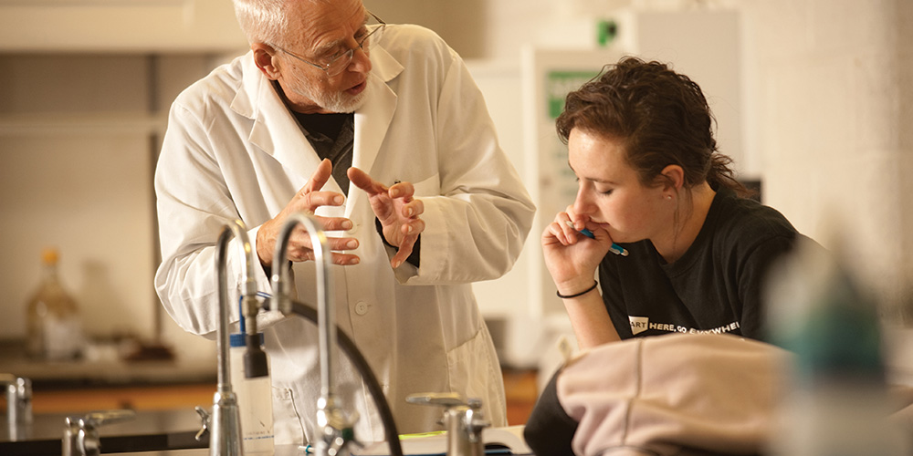 Jim Yoder '62 works with Kassade Thomas '13 in the chemistry lab.
