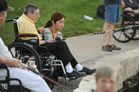 Misaki Murakami '15 (Osaka, Japan) fishes with Schowalter Villa resident Allen Bitikofer Ac38 at Lake Vista as part of Service Week.