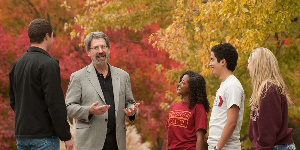 Hesston College History faculty member John Sharp visits with students on campus