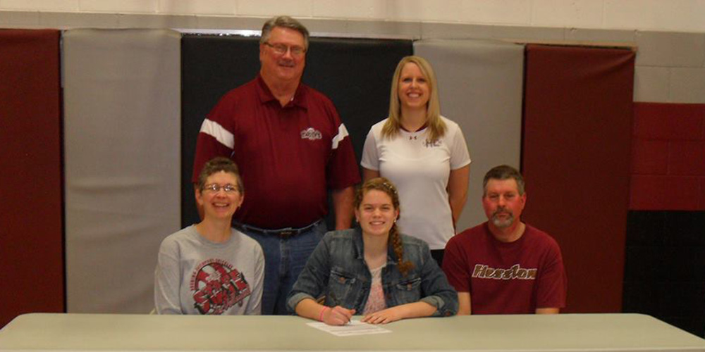 Christy Swartzendruber signs to play volleyball at Hesston College.