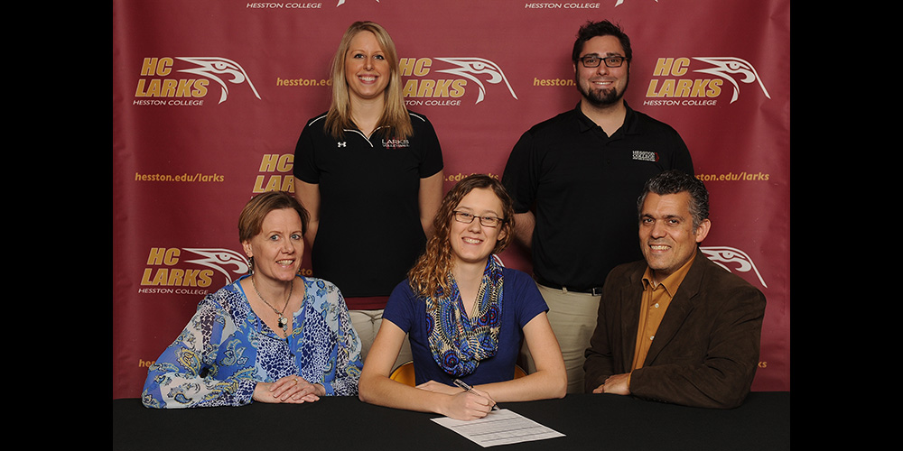 RaeLee Hightower signs to play volleyball for Hesston College.