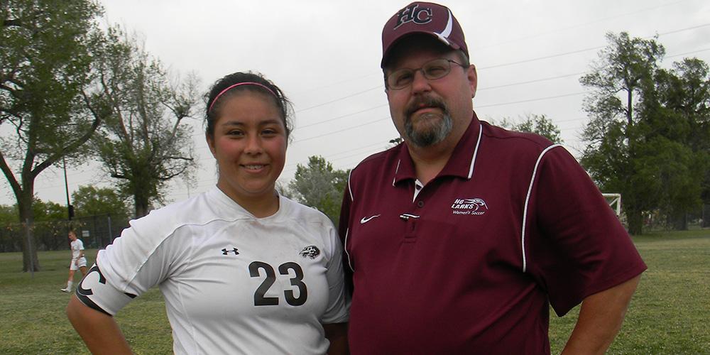 Enneliese Alcantar with Hesston College soccer coach Bryan Kehr