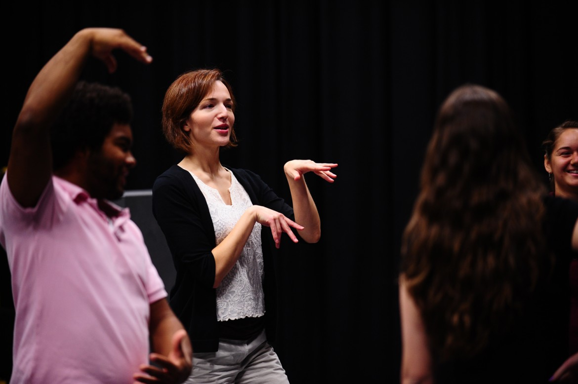 Hesston College theatre director Laura Kraybill leads an acting class through a warmup exercise. Kraybill will lead a week-long summer theatre camp for middle school-aged students June 2 to 7 on the Hesston College campus.