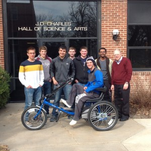 Hesston College Physics II students display the solar powered personal activities vehicle they built as a class project during the spring 2014 semester.