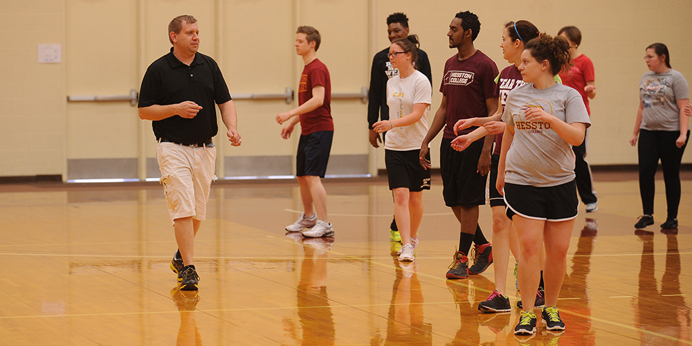 Hesston College physical education instructor Clay Stauffer gives instructions during a wellness class. The college will add exercise science as a program of study beginning with the 2014-15 year.