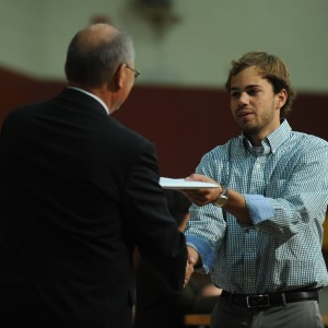 Mitchell Martin (Milford, Neb.), receives his Hesston College diploma from President Howard Keim.