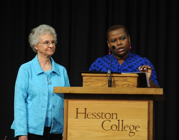 Hesston College natural science faculty member Marelby Mosquera (right) and nursing faculty member Joyce Huber (left) deliver a joint-address encouraging graduates to carry Hesston College values with them throughout life at commencement exercises May 11.