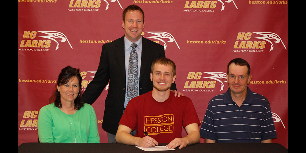 Matt Sanders signs to play basketball for Hesston College.