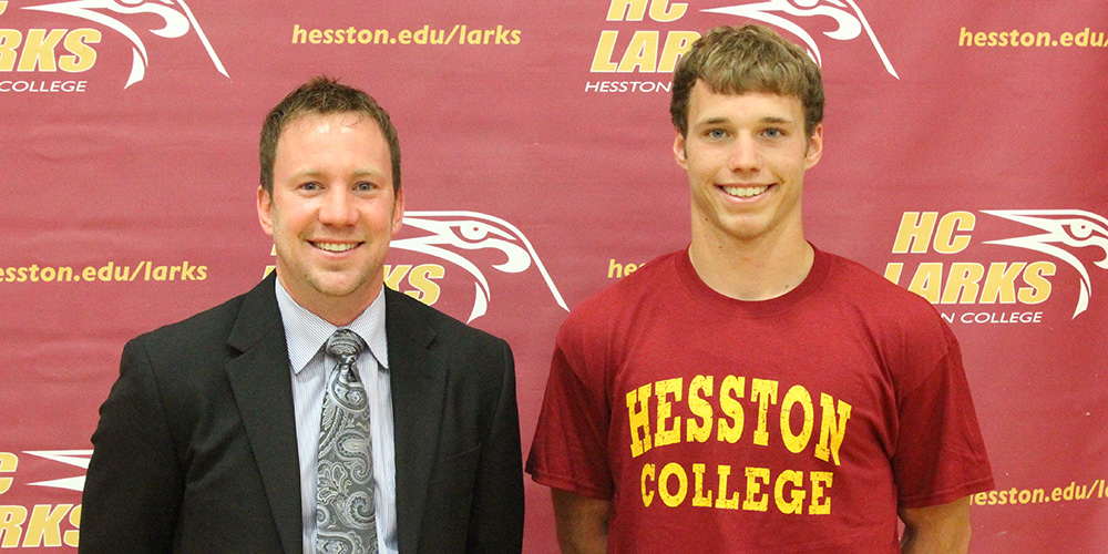 Hesston College men's basketball coach Dustin Galyon and Kaden Vanderpool