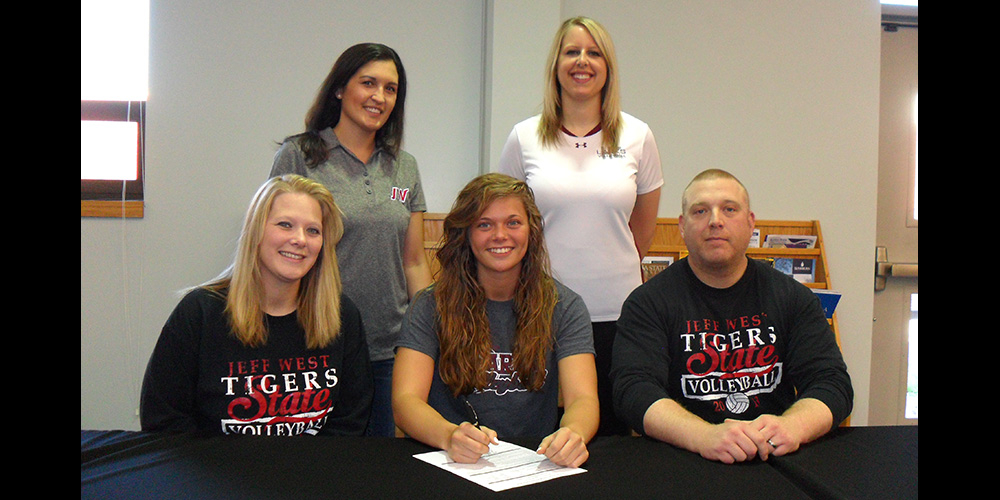 Jacey Guy signs to play volleyball for Hesston College.