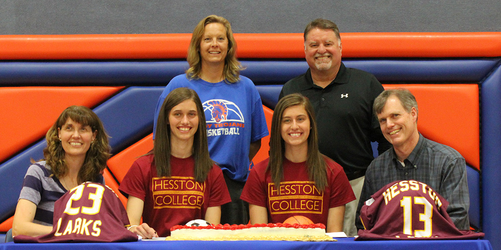 Erin and Morgan Coffman sign to play basketball for Hesston College.