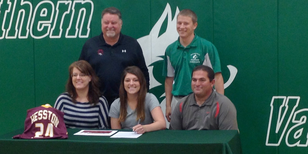 Brooke Hammond signs to play basketball for Hesston College.
