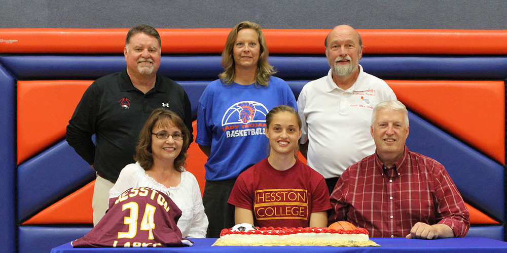 Brittany Kramer signs to play basketball for Hesston College.