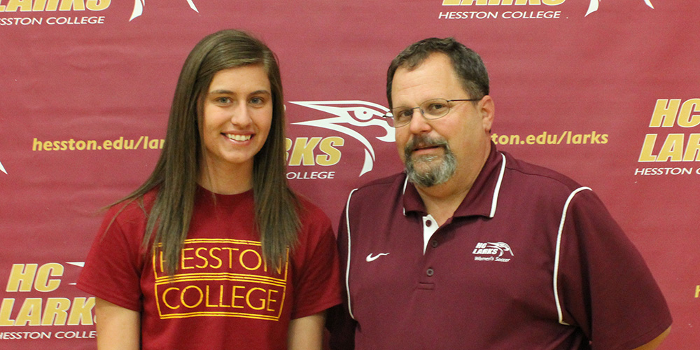 Erin Coffman and Hesston College women's soccer coach Bryan Kehr