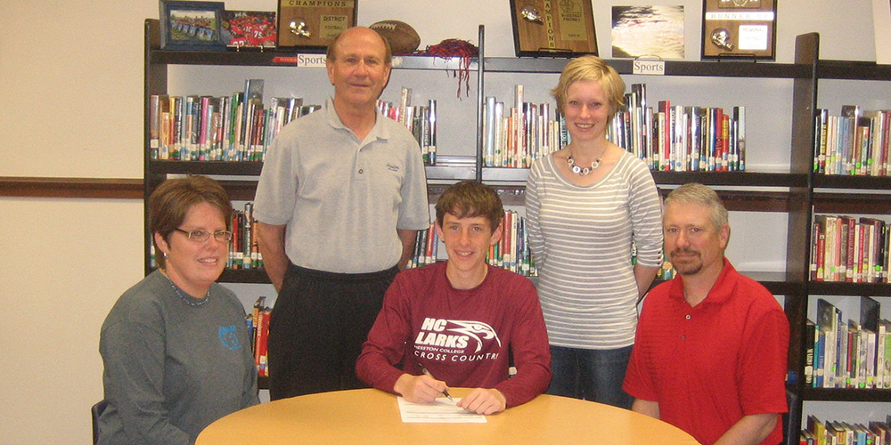 Jared Hague signs to run cross country for Hesston College.