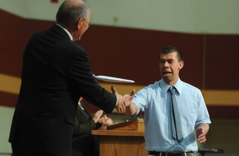 Simon Zehr receives his diploma from President Howard Keim
