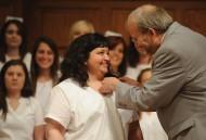 Kristal Potter receives her nursing pin from nursing faculty member Gregg Schroeder.