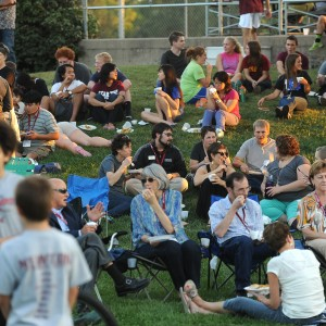 Hesston College students, alumni and friends enjoy a tapas meal on the lawn