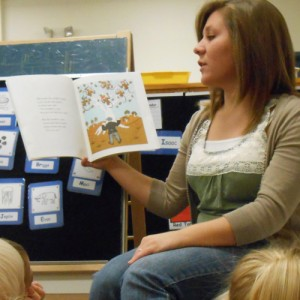 Morgan Martin reads to students at Hesston College Preschool