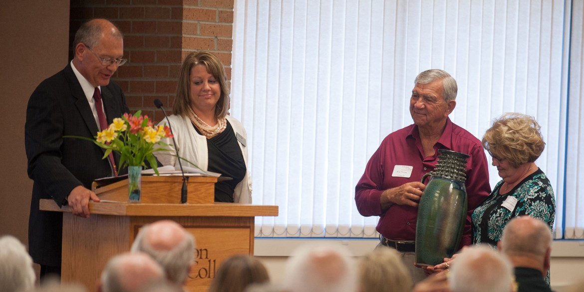 President Howard Keim '72 and Interim Vice President of Advancement Tonya (Hunsberger) '94 Detweiler present Doug '62 and Connie Dorsing with a gift of appreciation for their $1 million gift to the college at the annual Partner Luncheon Sept. 27.