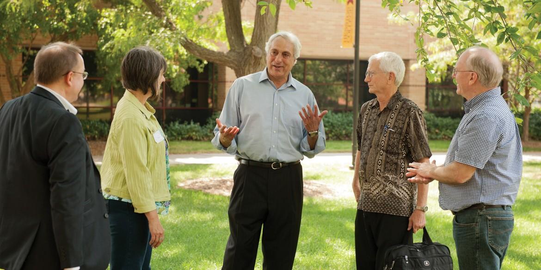 Sadi Othman (center) visits with Ken Rodgers, Margie Wiens, Dave Osborne and Ernst Wiens.