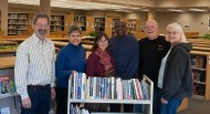 Hesston College alumni Bruce and Joy Rogers, right, donated 65 books on civil rights and African-American history to the college's library. Pictured with the Rogers, from left, are history instructor John Sharp, librarians Margaret Wiebe and Donna Diener and sociology instructor Tony Brown. Rogers will co-lead a spring break trip commemorating the 50th anniversary of the civil rights march from Montgomery to Selma, Ala., in March with Brown and Sharp.