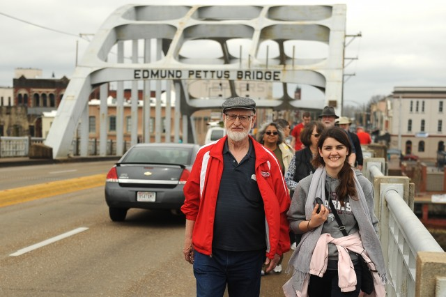 Former Hesston College Bible faculty member Marion Bontrager and freshman Irena Xhari cross the Edmund Pettus Bridge in Selma, Ala.