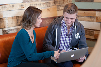 Roby Miller discusses strategic planning with Courtney Henecke, Telepharm operations manager. Photo by Jodi Gehman, Gehman Photography