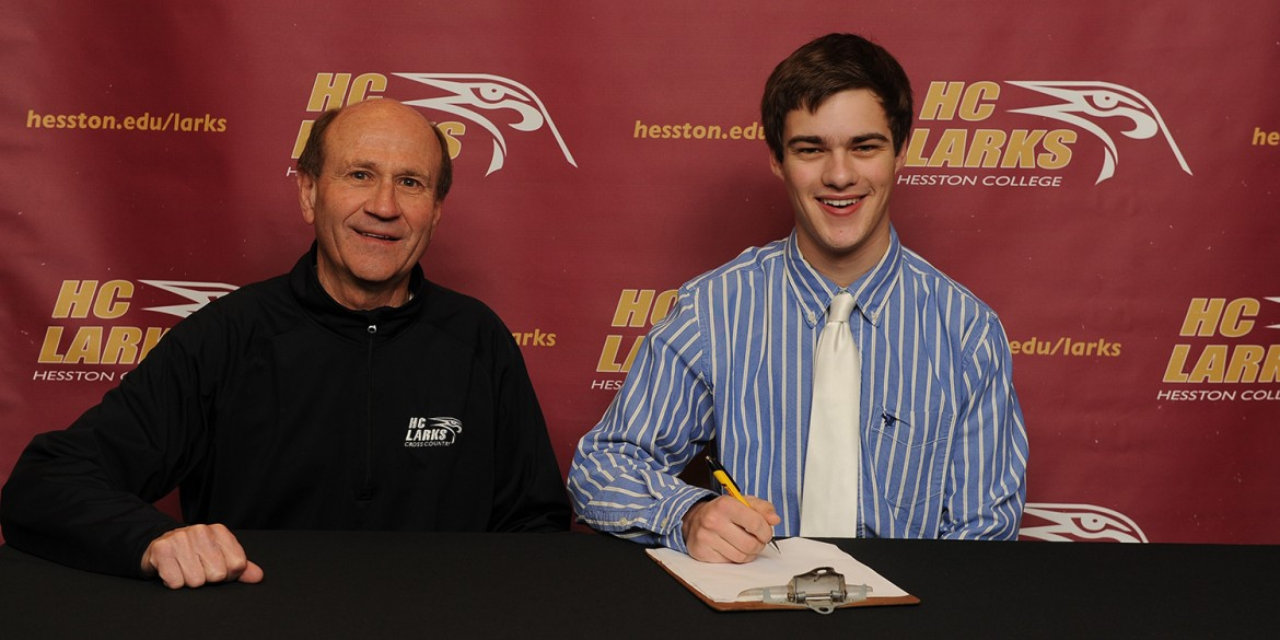 Hesston College Cross Country Coach Gerry Sieber with Jonah Short-Miller