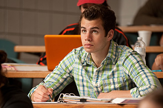 Greg Nolt '13 (Partridge, Kan.) takes notes during a class lecture.