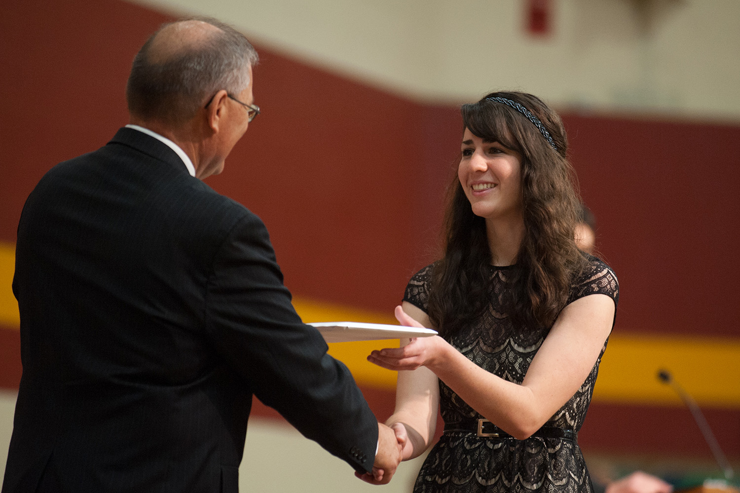 Elisabeth Wilder '15 (Hesston, Kan.) recieves her diploma. President Howard Keim conferred 148 degrees for the class of 2015.