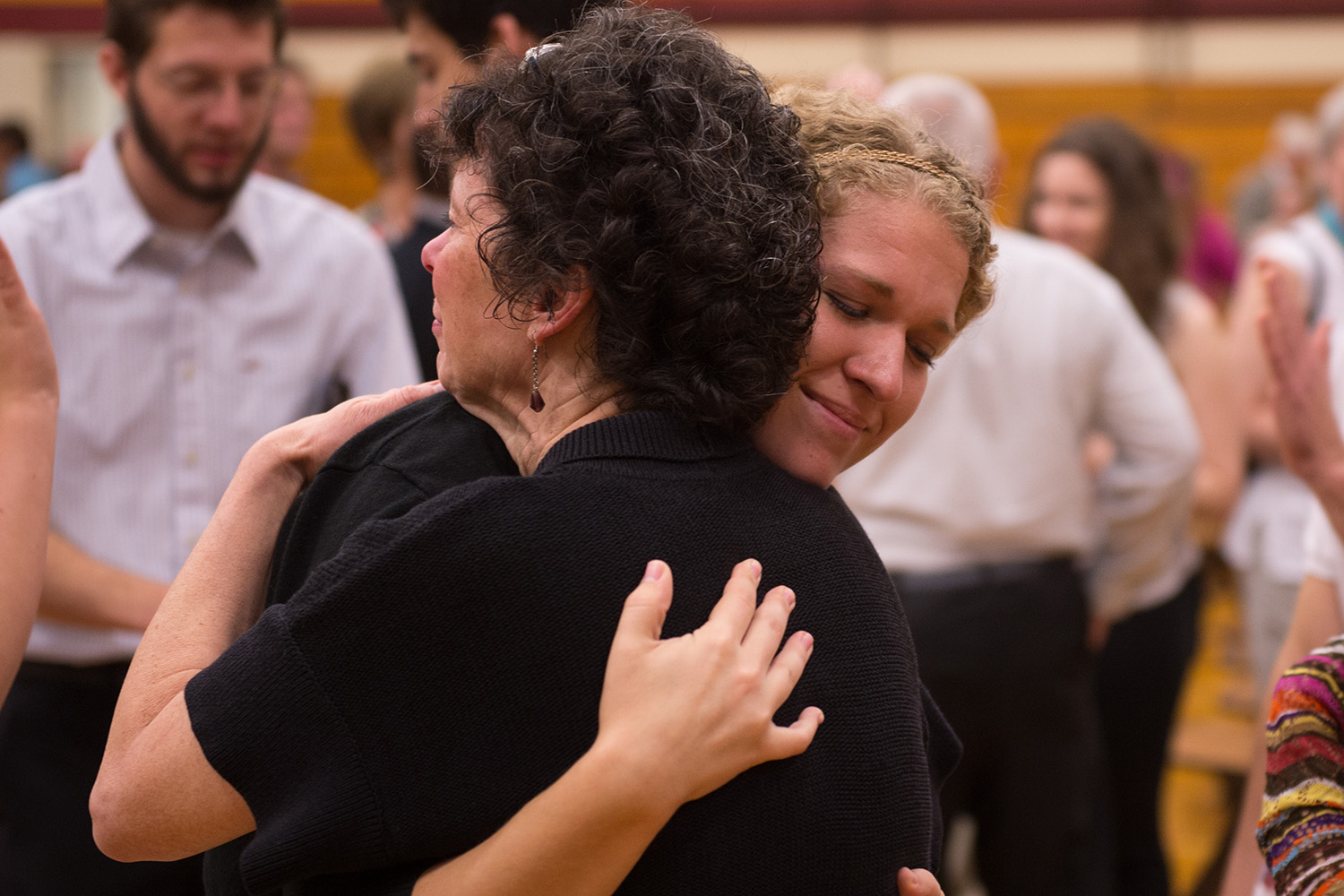 Taylor Zehr '15 (Wauseon, Ohio) hugs Bible and ministry faculty member Michele (Schrock) '81 Hershberger.