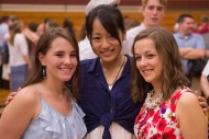 Rachel Jantzi and Mary Bender celebrate their accomplishments with Yui Soshizaki.