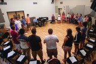 The Bel Canto Singers warm up on their first practice of the year in the Sauder Vocal Music Room.