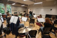 The Chamber Orchestra, under the direction of Rebecca Schloneger, rehearses in the Mabee Instrumental Music Room named in honor of the J.E. and L.E. Mabee Foundation of Tulsa, Okla.