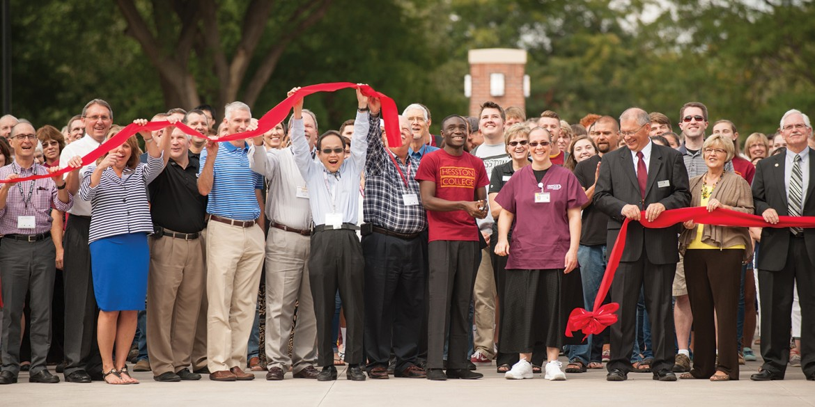 College and City of Hesston officials participate in the ribbon cutting for the college's new campus entry Sept. 25.
