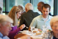 Cory Rychener '10 and Kelsey Gardiepy enjoy lunch at the annual Partner Luncheon where Austin Mitchell '15 and Grant Walker '15 shared their Hesston Experience story. Mitchell and Walker became friends as members of the men's basketball team and are now roommates and playing basketball at Bethel College (North Newton, Kan.).