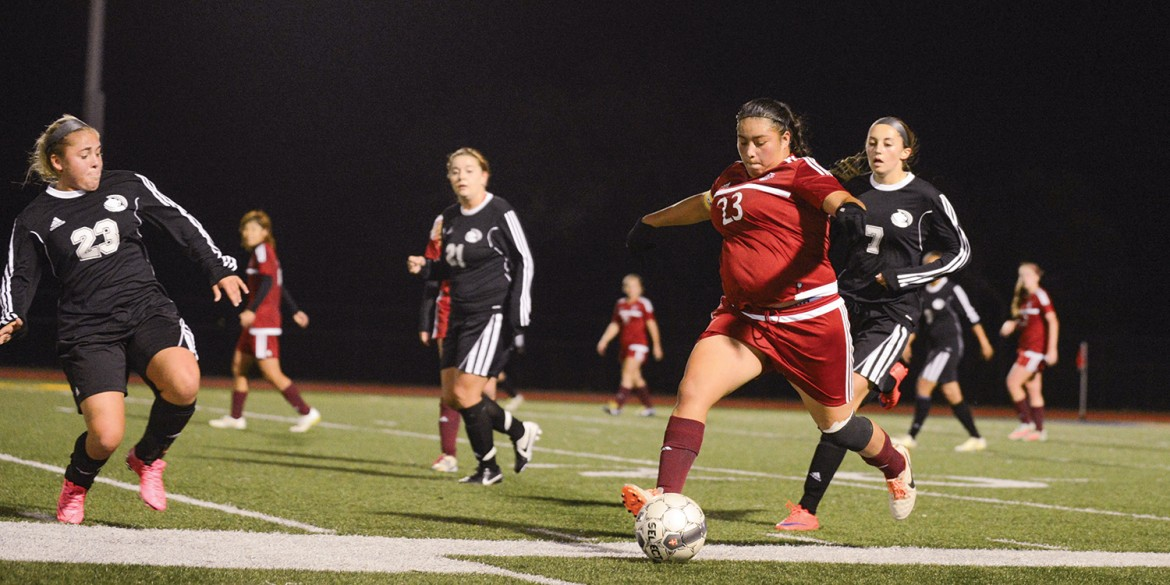 Enneliese Alcantar drives the ball up the left sideline in the playoff game vs. Butler County.