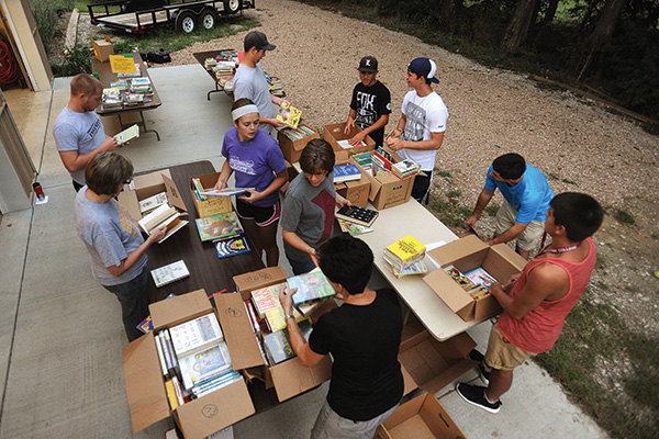 Students and staff sort and package books for Ethiopia Reads, a program that collaborates with communities in Ethiopia to build schools, plant libraries, train educators and boost literacy.